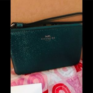 Coach wristlet new with care tags and gift box